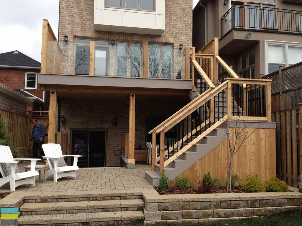 Pvc deck with glass railings and walkout basement for Deck ideas above walkout basement