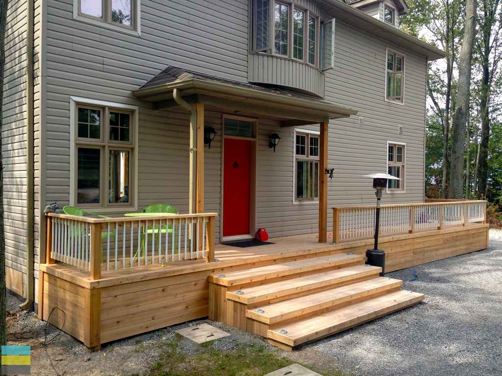 Front cedar porch with skirt , steps, aluminum railings, cedar posts, landscaping
