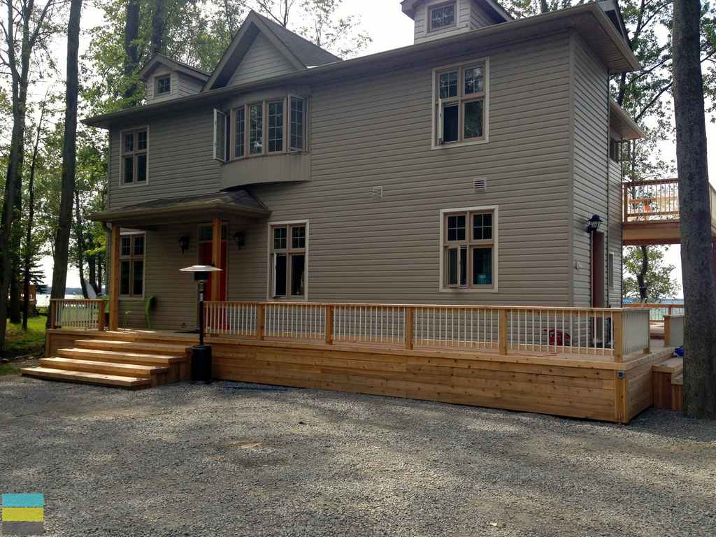 Two level cedar deck, cedar front porch, steps, landscaping, stone pebble driveway