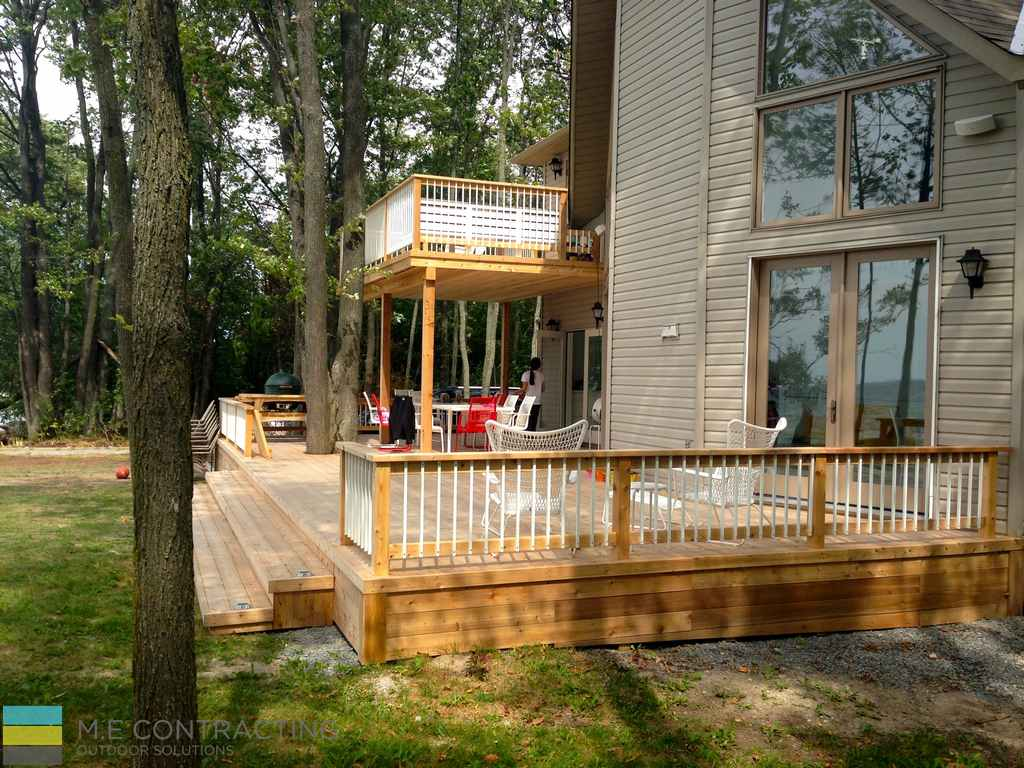Two level cedar deck, aluminum railings with cedar posts, landscaping, M.E. Contracting