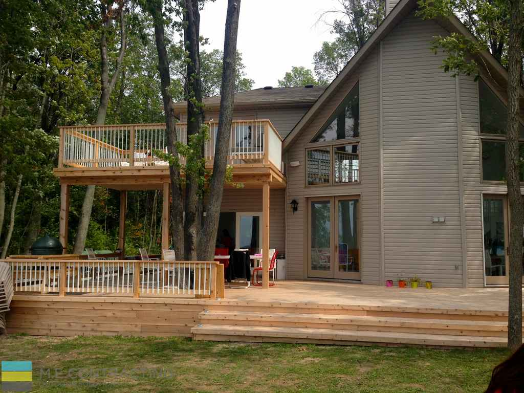 Two level cedar deck, aluminum railings with cedar posts, landscaping