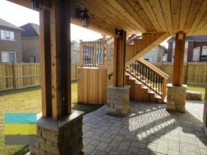 Cedar deck, interlocking, landscaping, coping stone, steps with skirt and storage, lighting, cedar fence, aluminum railings, pergola