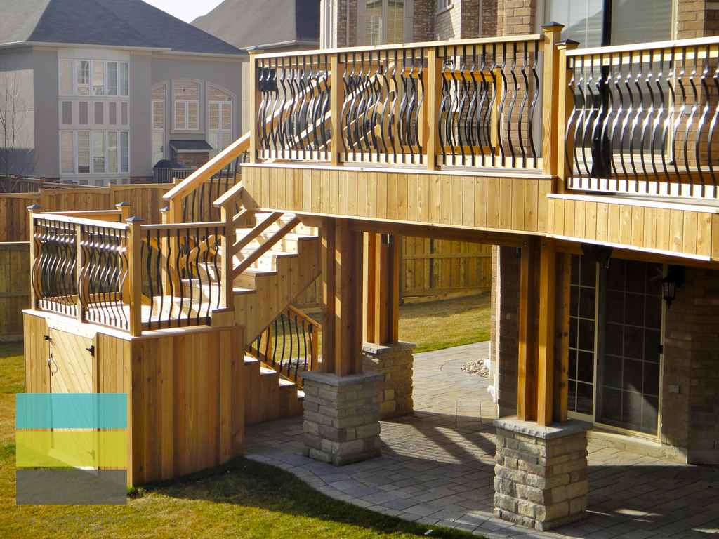 2 level cedar deck with wrought iron railings pergola and Walkout basement deck designs