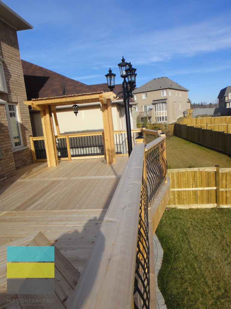 Cedar deck, interlocking, landscaping, coping stone, steps with skirt and storage, lighting, cedar fence, aluminum railings