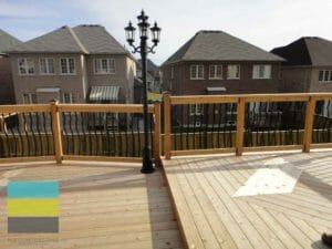 Cedar deck, interlocking, landscaping, coping stone, steps with skirt and storage, lighting, cedar fence, aluminum railings