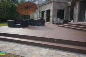PVC deck, landscaping, and interlocking with outdoor furniture