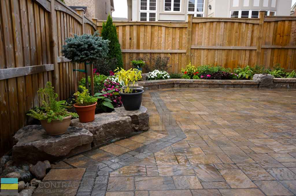 2 level interlock patio with retaining walls and large Backyard landscaping ideas with stones