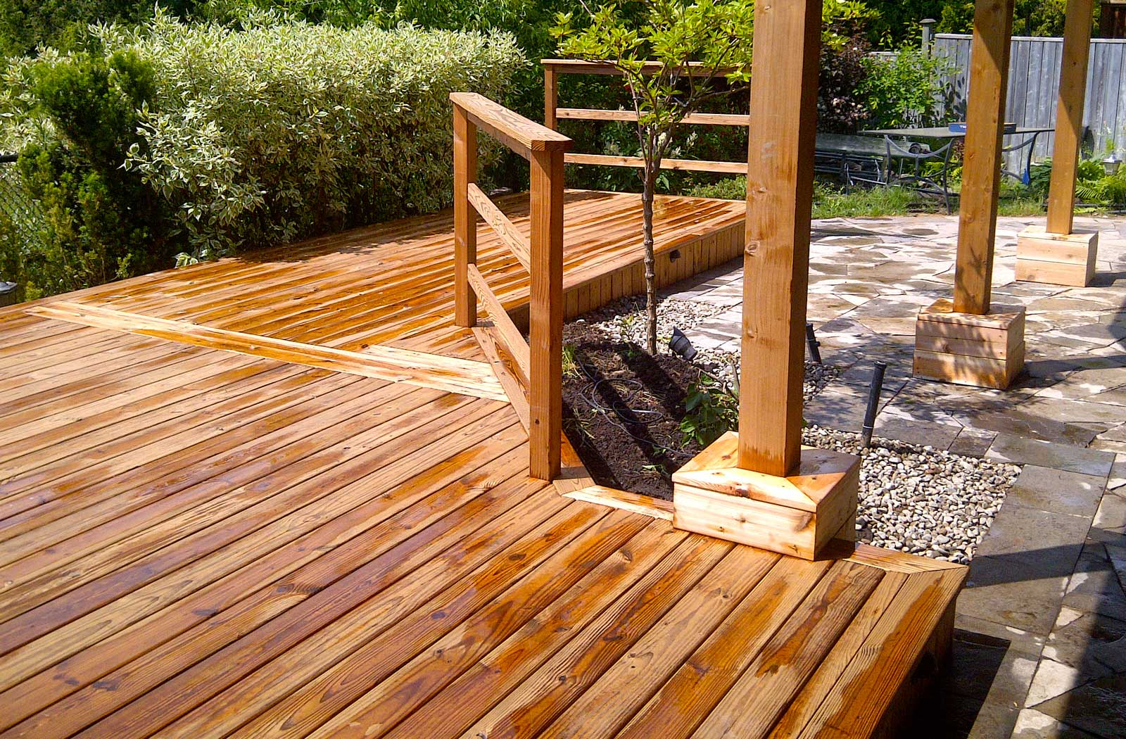 Cedar deck, interlocking, stone pebbles, landscaping, cedar railings,