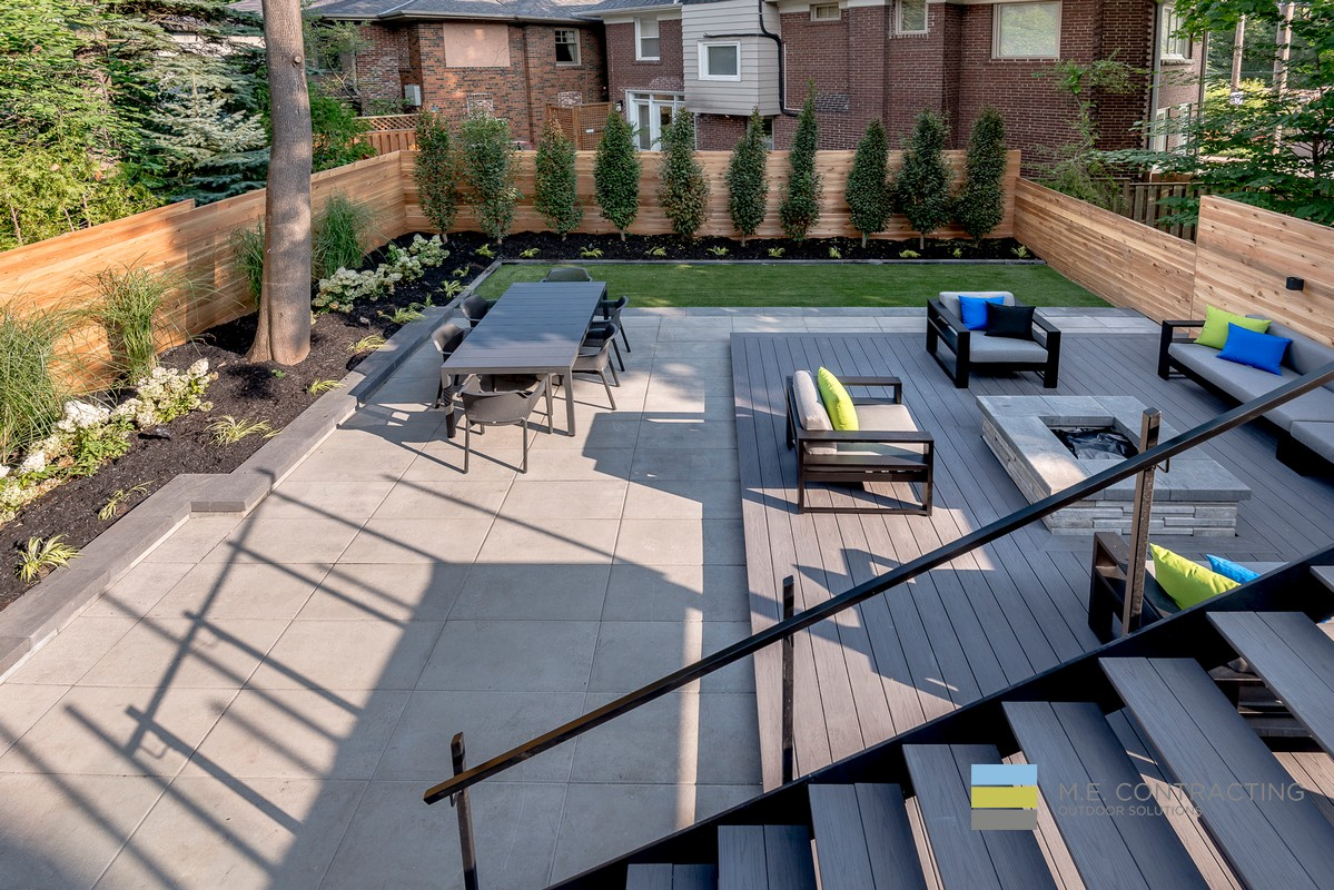 Modern Backyard Design With Fireplace Outdoor Kitchen And Deck