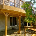 cedar deck and railings with flagstone patio