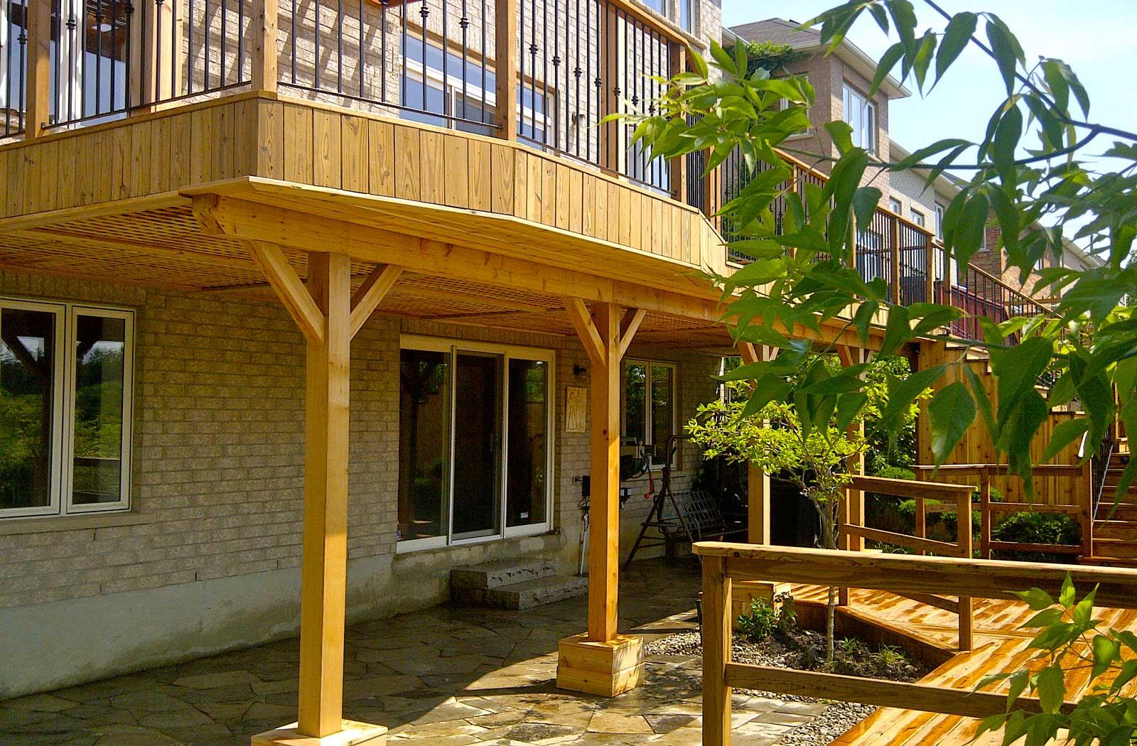 cedar deck and railings with flagstone patio