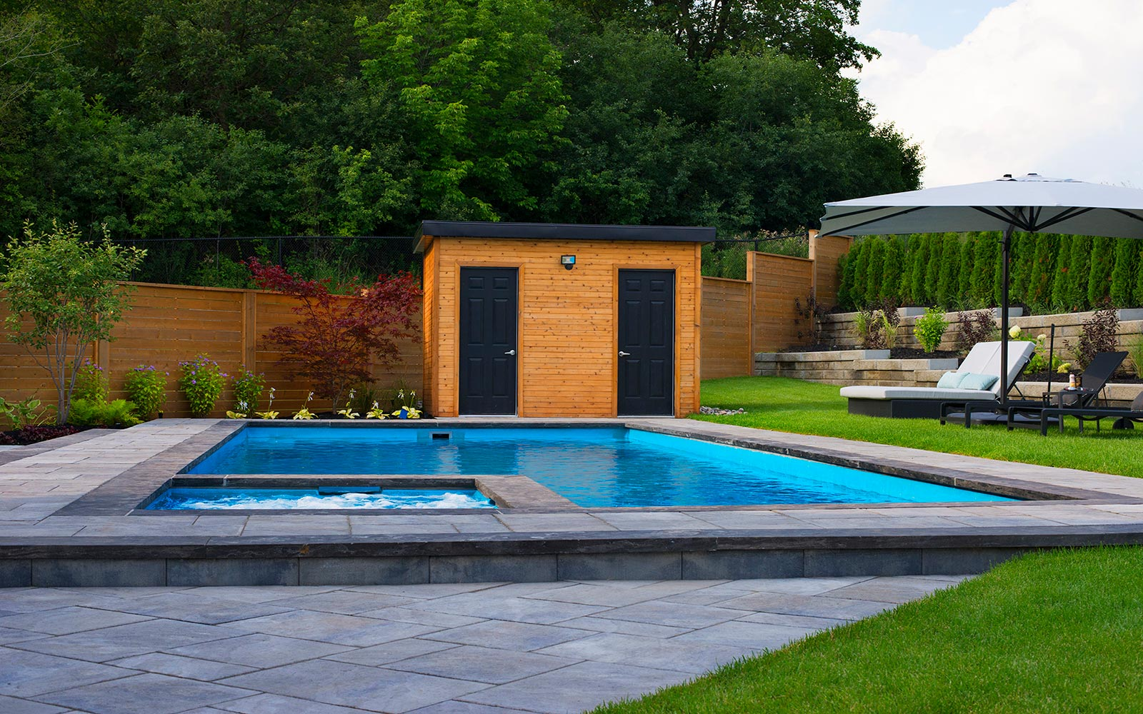 Cedar Point, Landscaping Project; Featuring Concrete Pool Installation, Pool Deck Interlocking & Retaining Wall by Toronto Landscaping Company.