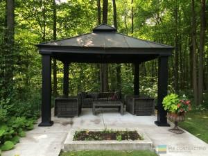 Aluminum gazebo, landscaping, stone patio, pergola