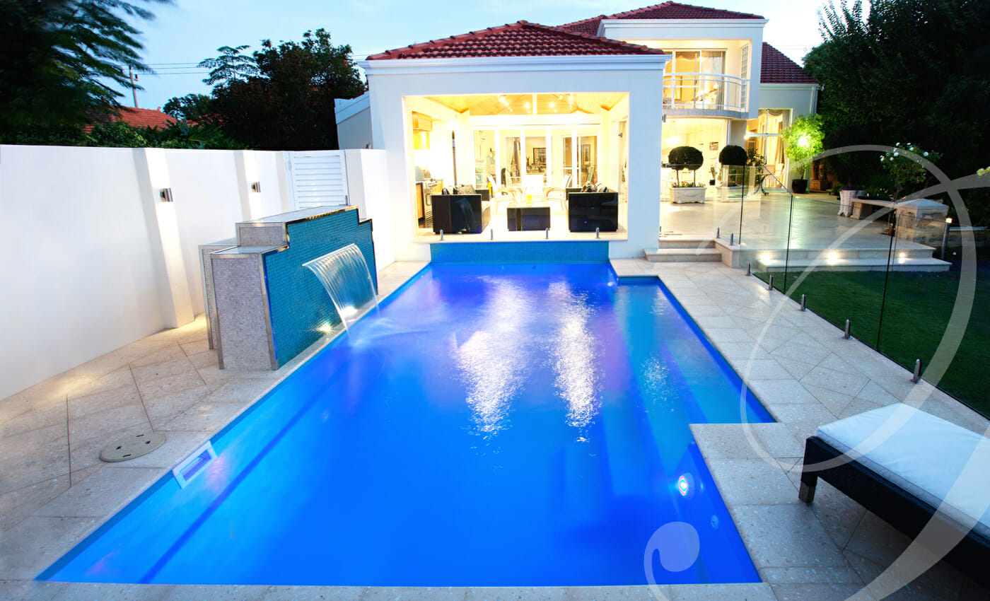 Elegance fiberglass pool design with water feature and coping by Leisure Pools