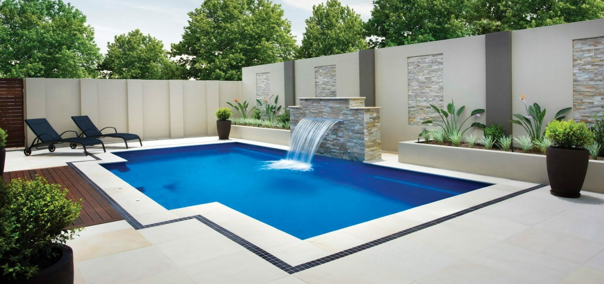 Modern Elegance fibreglass pool with water feature and coping by Leisure Pools