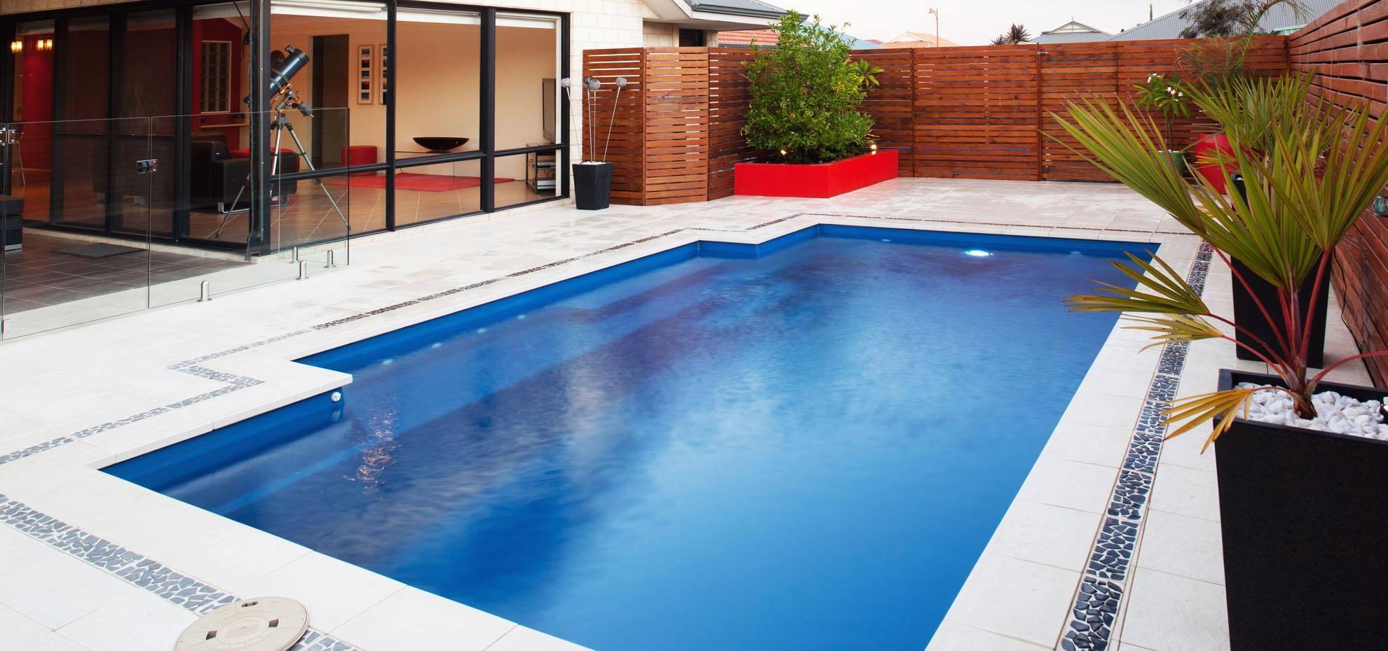 Elegance fibreglass pool with coping by Leisure Pools
