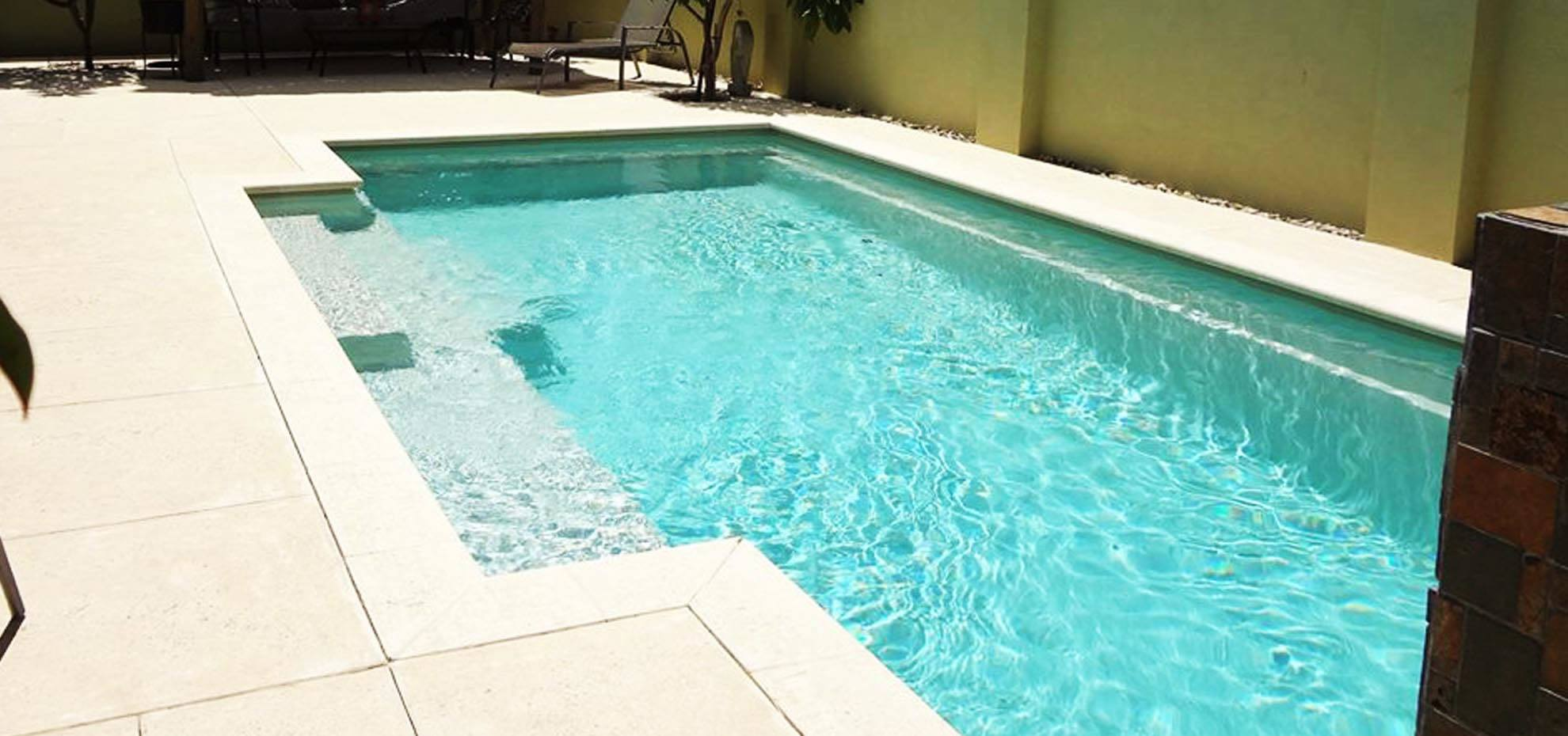 Elegance style fibreglass pool with coping by Leisure Pools