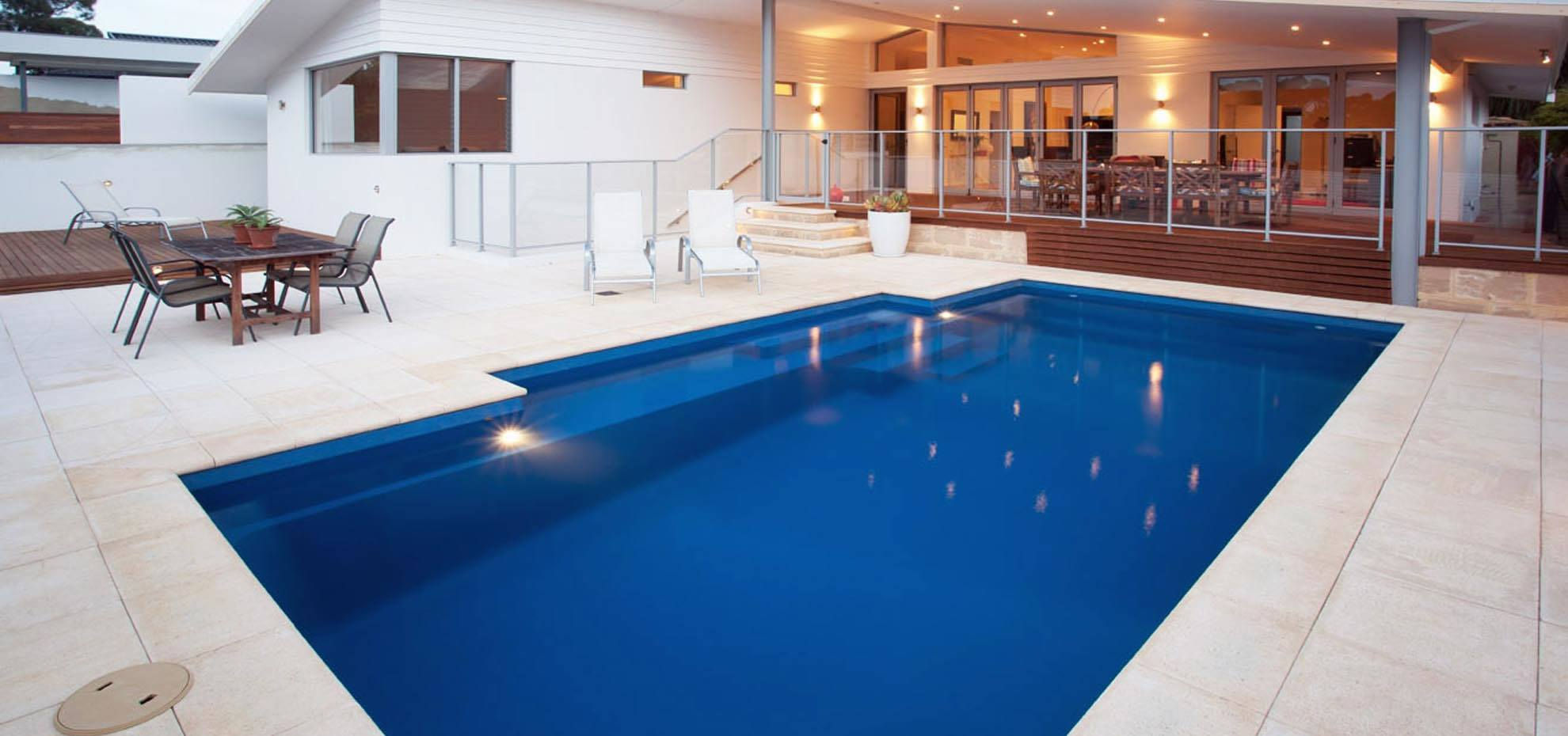Elegance fibreglass pool design with coping by Leisure Pools