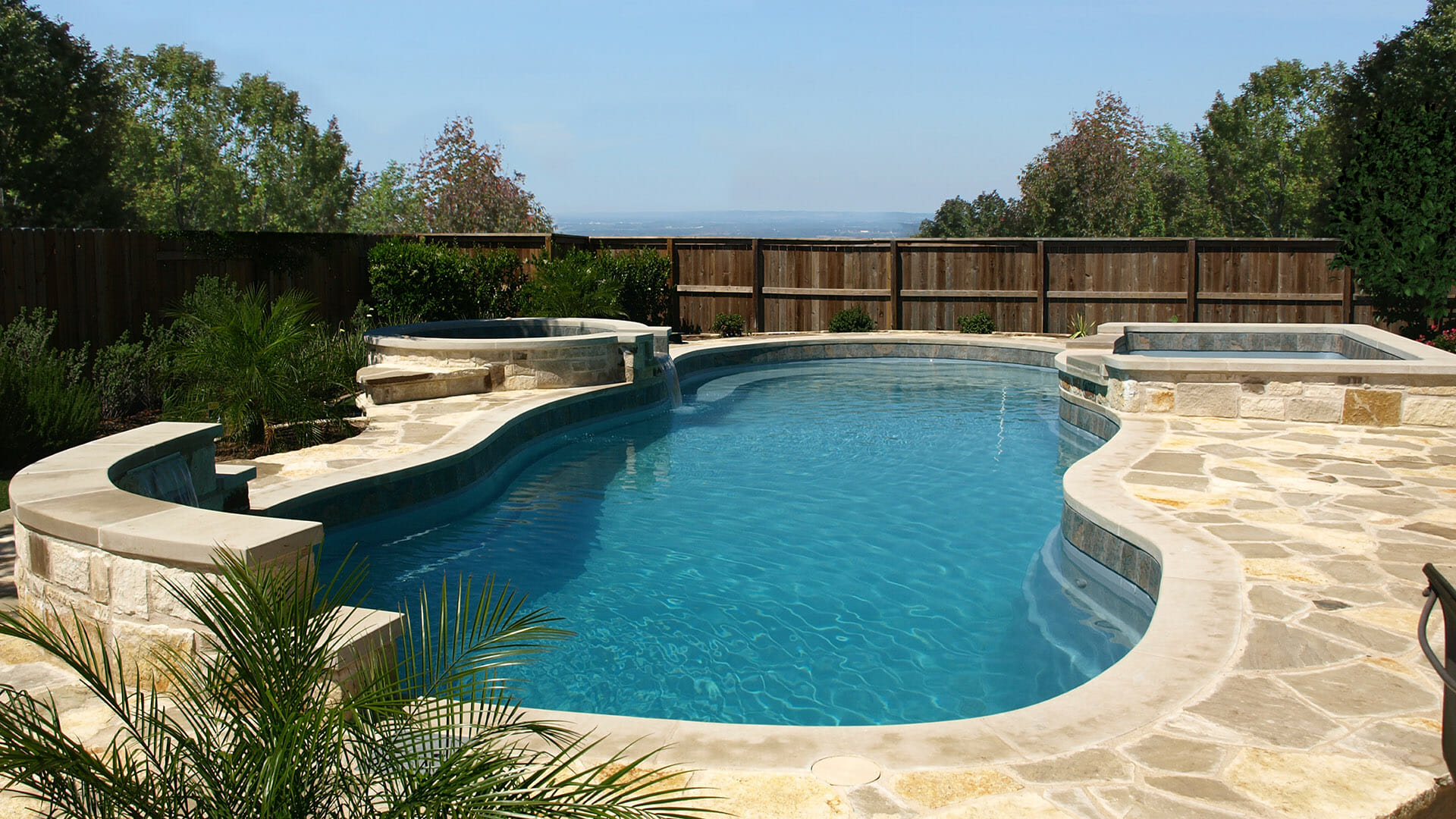 Caribbean Fiberglass pool with side pools by Leisure Pools