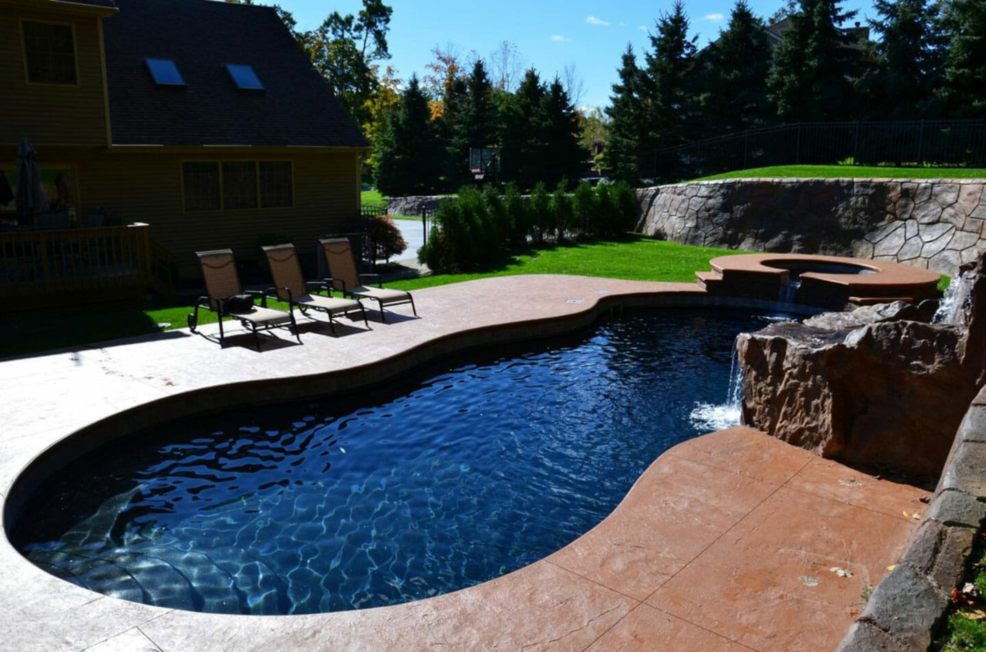 Carribean Fibreglass Pool with coping and side pool by Leisure Pools