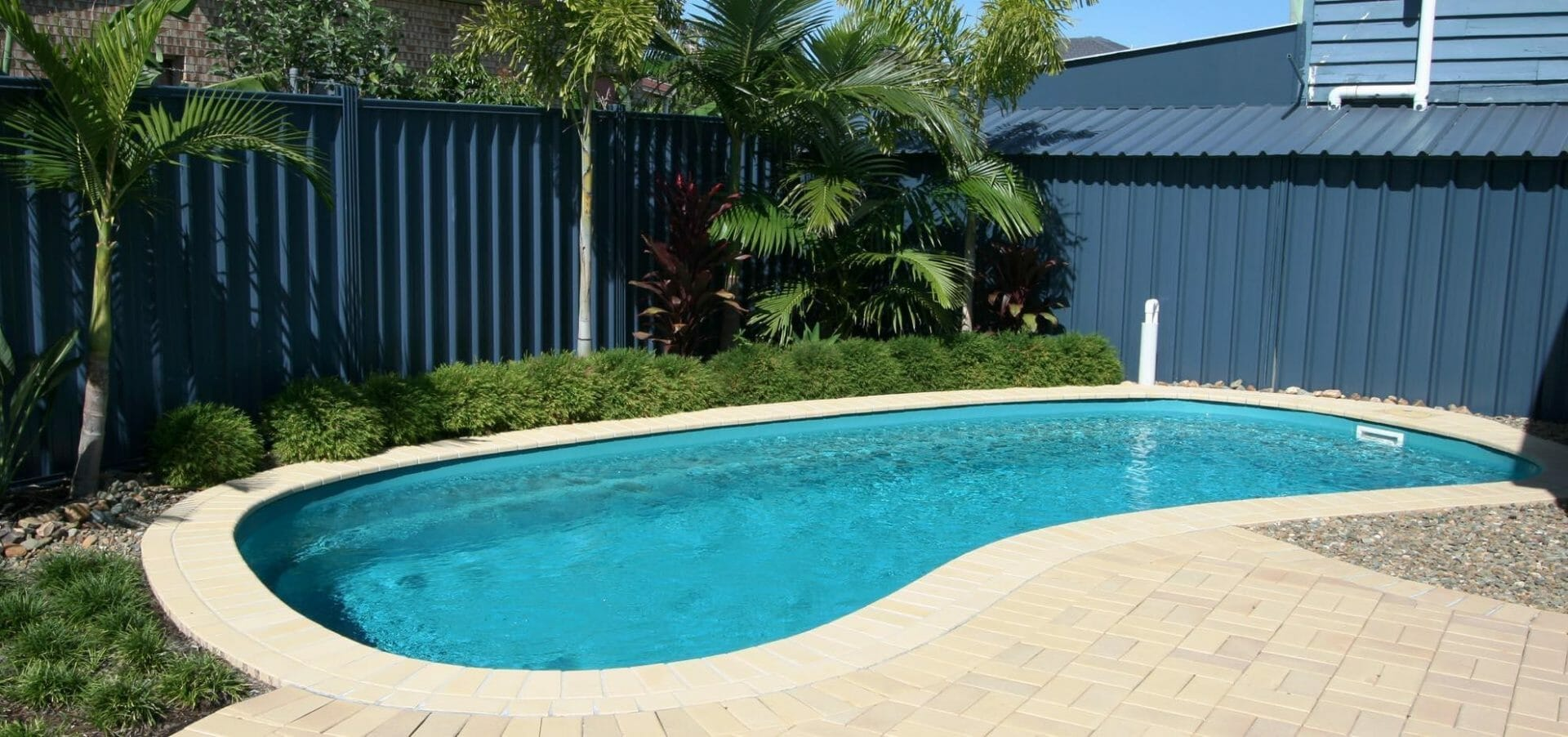 Tuscany Fiberglass Pool with interlocking by Leisure Pools