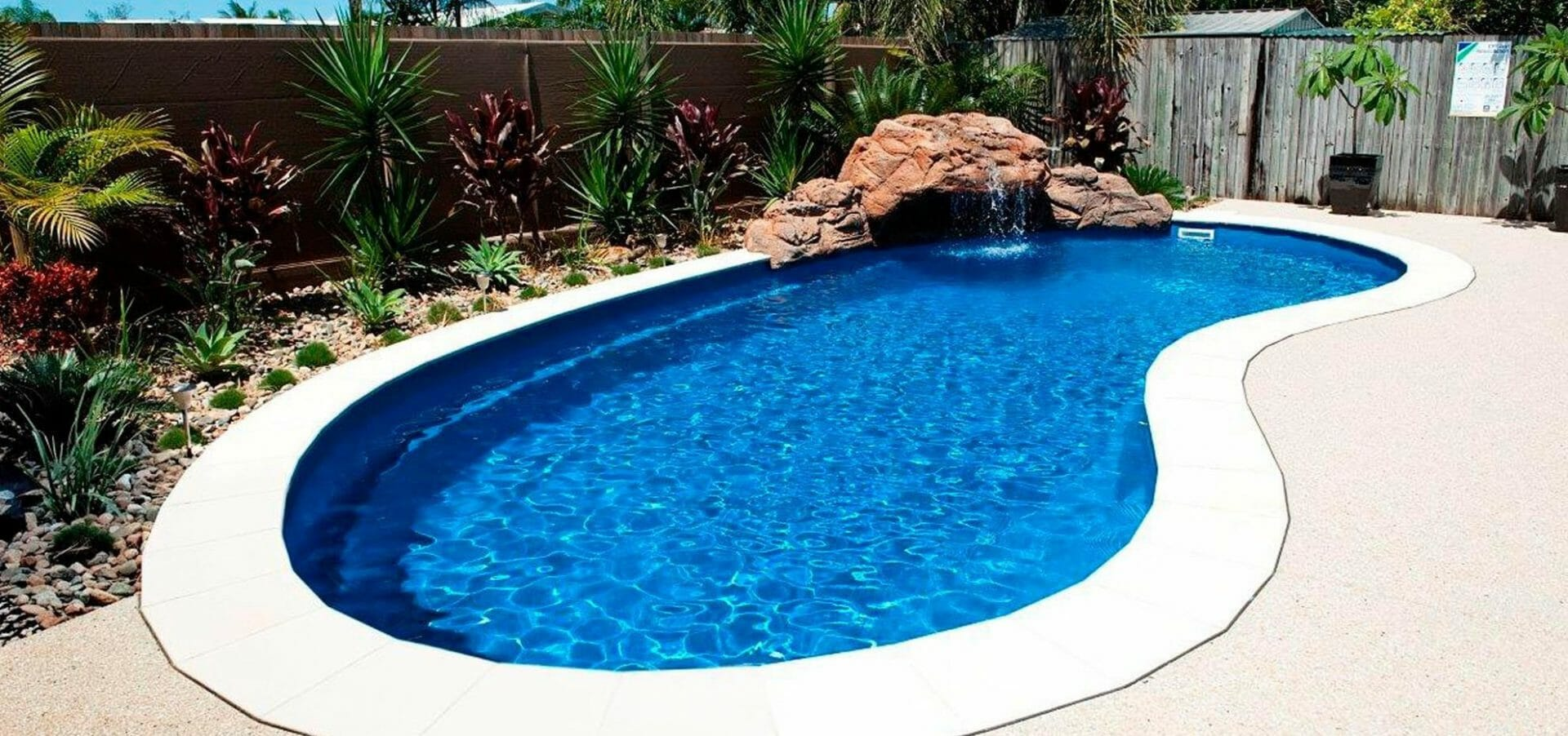 Tuscany Fibreglass pool with water feature and coping by Leisure Pools