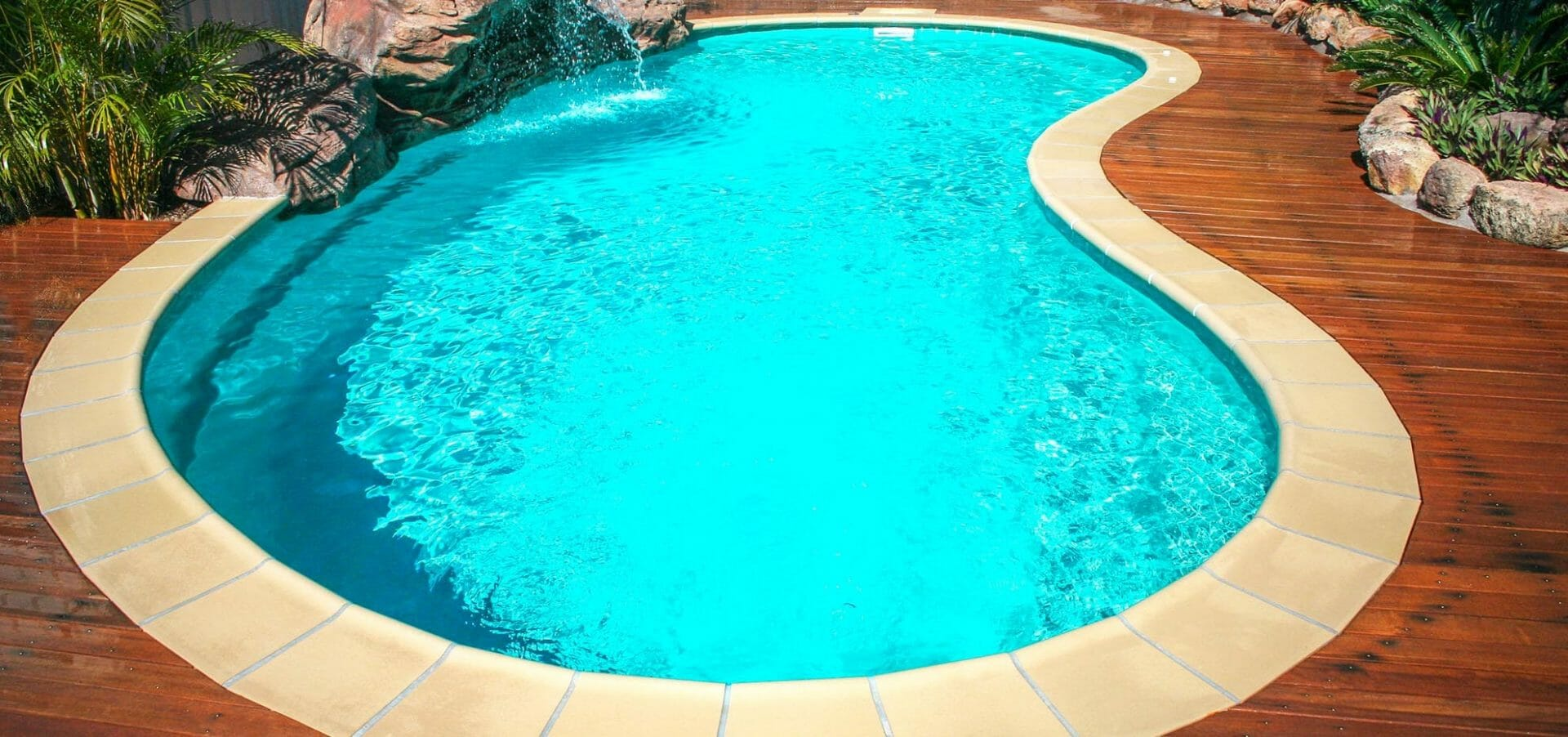 Fiberglass Tuscany Pool with cedar deck by Leisure Pools