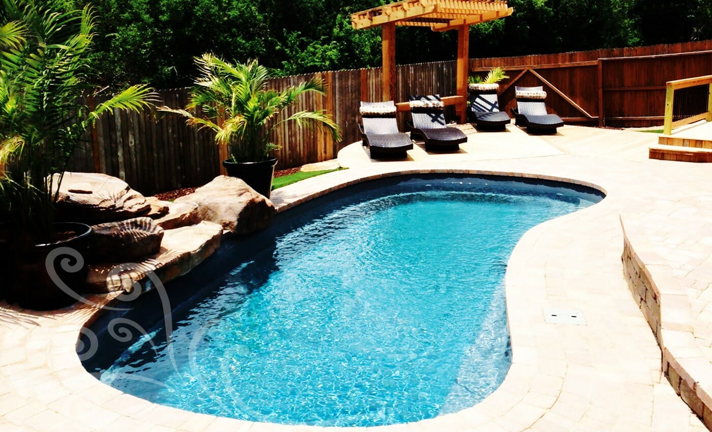 Fibreglass Tuscany Pool with cedar pergola and coping by Leisure Pools