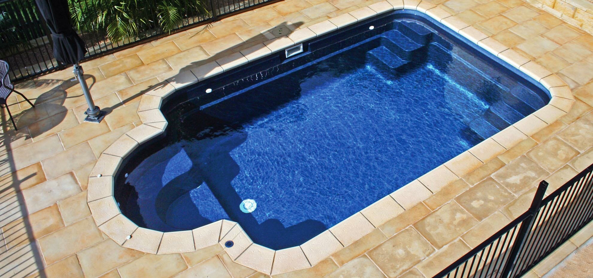 Custom Fibreglass pool design with coping by Leisure Pools