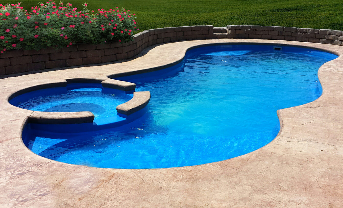 The custom Allure fibreglass pool with water feature and coping by Leisure Pools