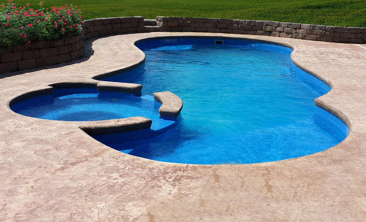 The Allure Fibreglass pool design with side spa and coping by Leisure Pools