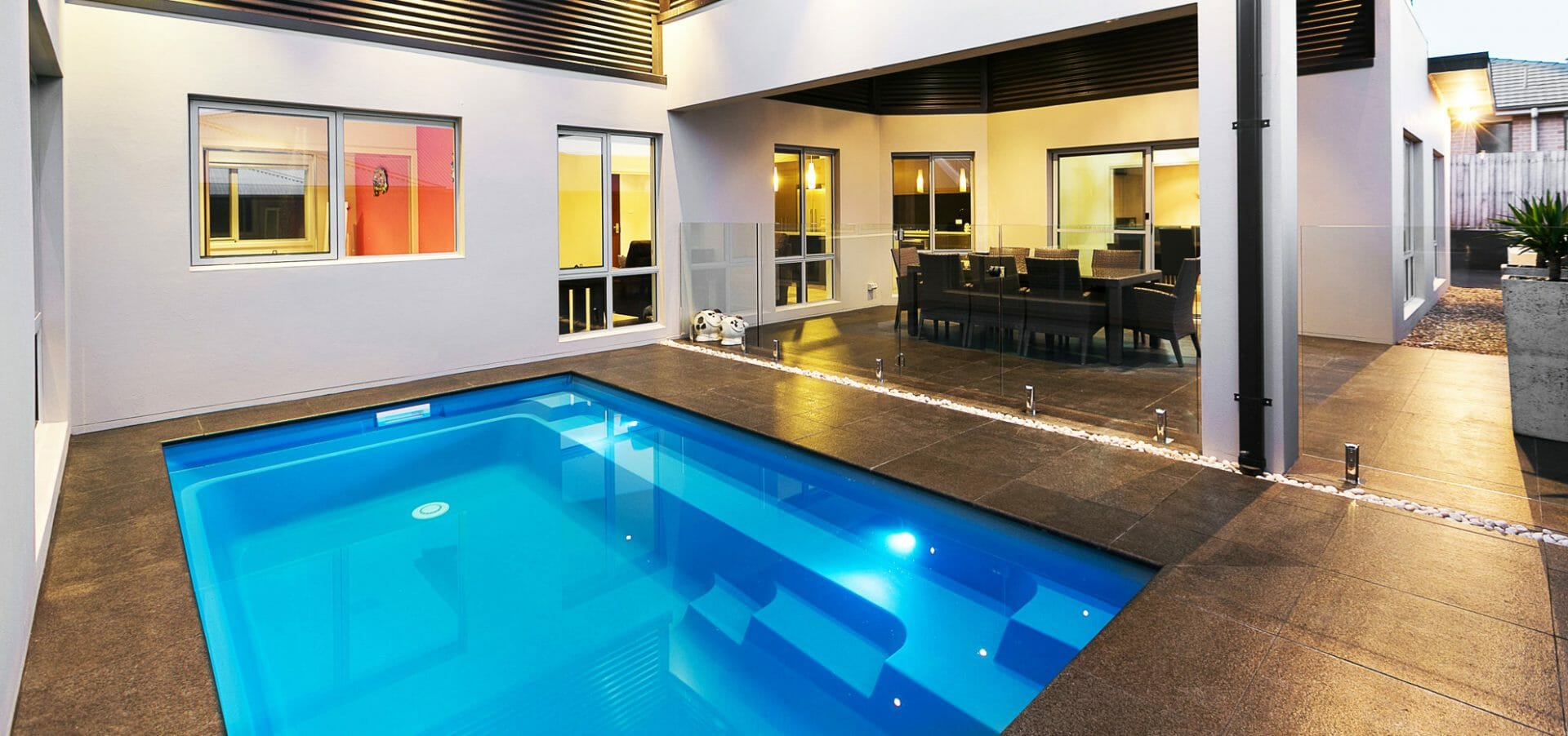 Harmony Fibreglass Pool with coping and lighting by Leisure Pools
