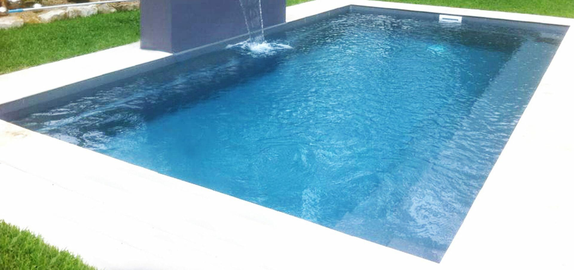 Harmony design Fibreglass pool with water feature and coping by Leisure Pools
