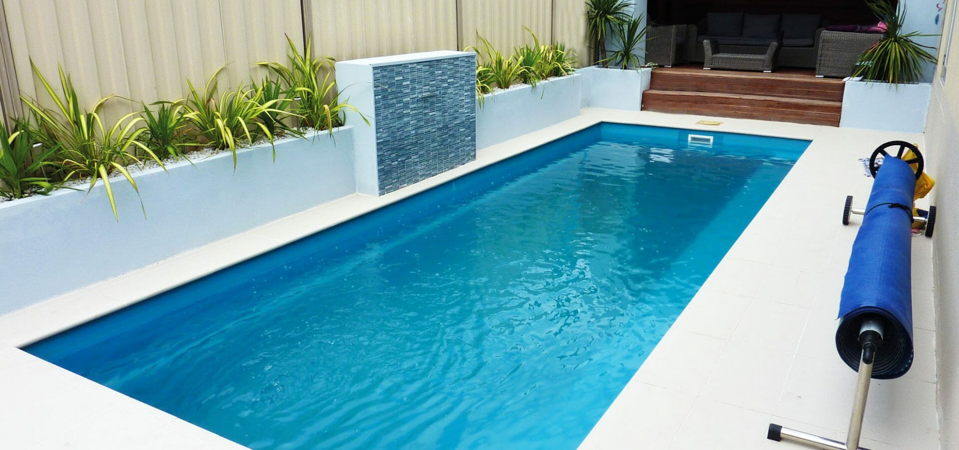 Rectangular Harmony fibreglass pool with water feature by Leisure Pools