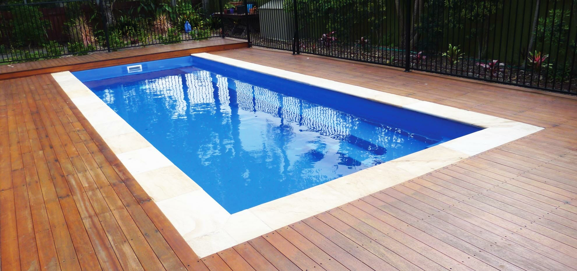 Harmony style fibreglass pool with coping by Leisure Pools