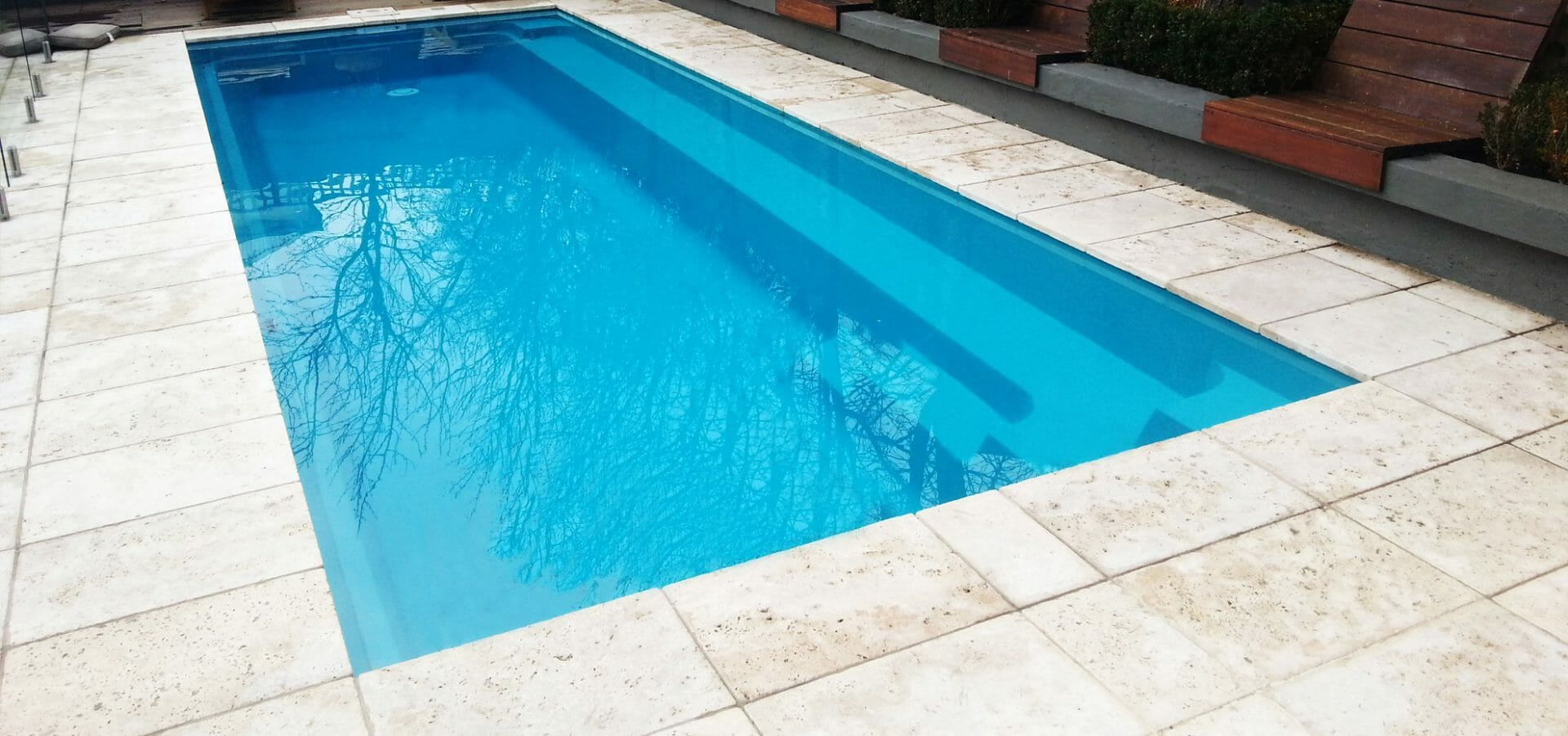 Harmony design fibreglass pool with coping by Leisure Pools