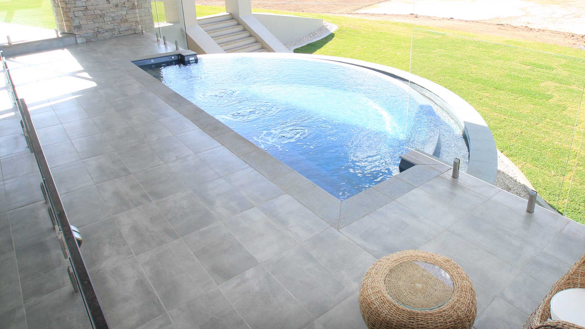 Horizon Fibreglass Pool with water features and coping by Leisure Pools