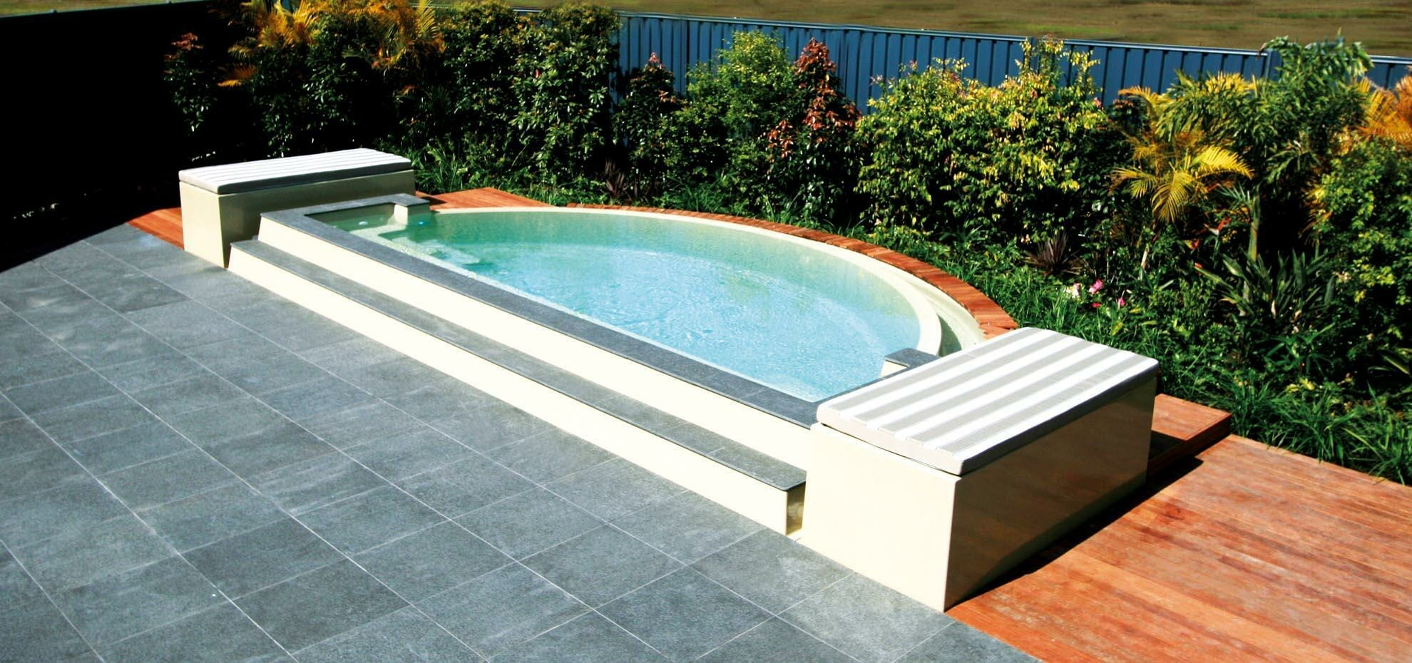 Horizon style fibreglass pool with infinity feature and coping by Leisure Pools