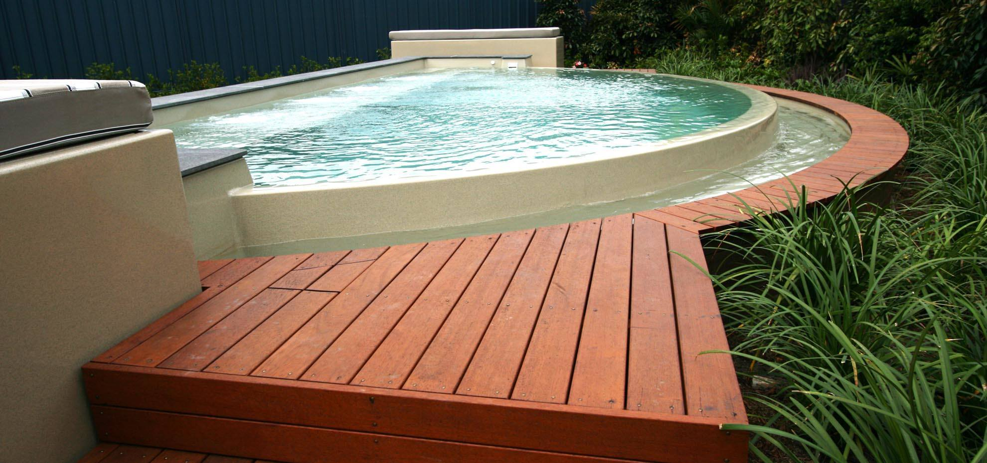 Horizon style fibreglass pool with infinity feature by Leisure Pools