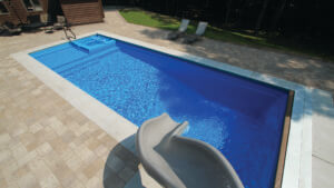 Icon fibreglass pool with coping by Leisure Pools