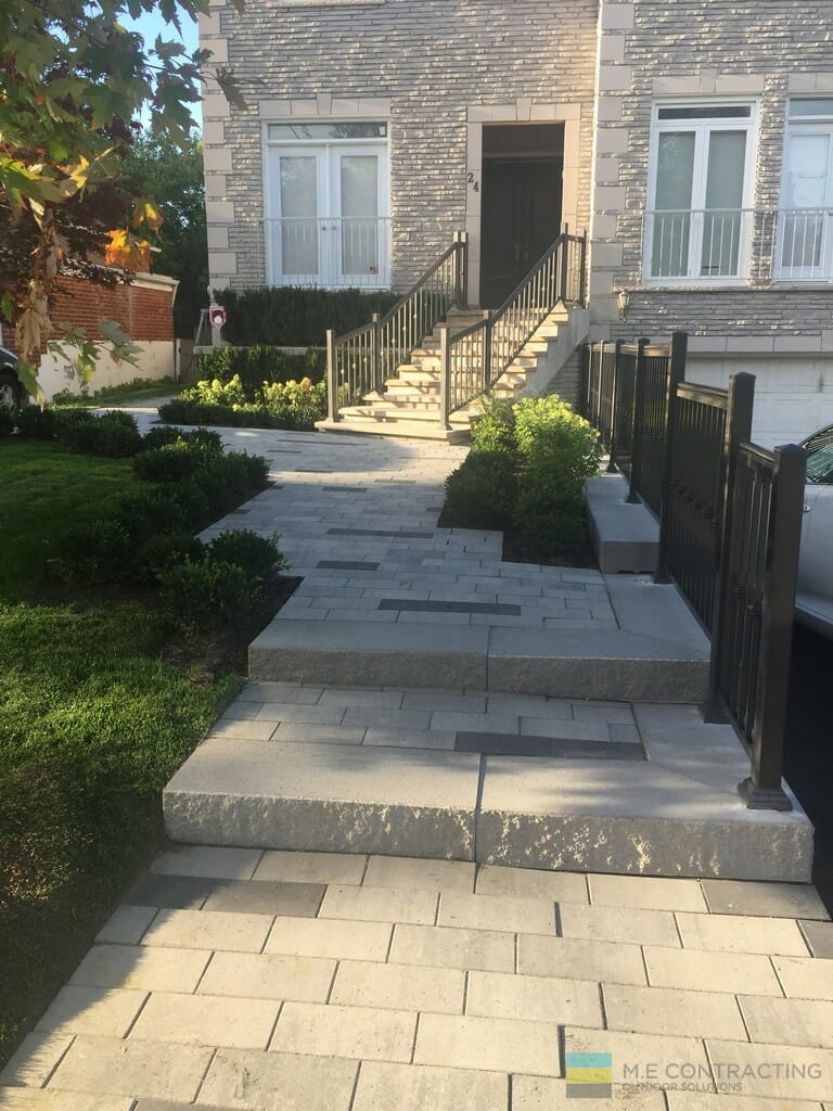 Interlocking stone walkway with stainless steel railings