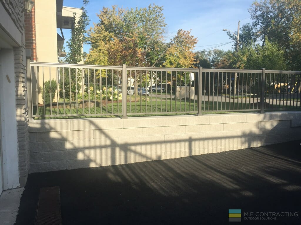 Interlocking project with stainless steel railings and retaining wall