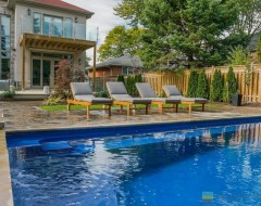 Landscaping with fiberglass pool, interlocking patio, cedar deck and fence, tempered glass railings with stainless steel posts and clips