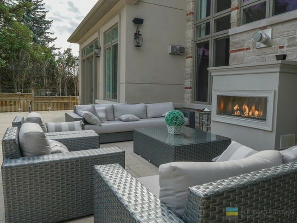 Stone deck, fire place, stone veneer, tempered glass railings with stainless steel posts and clips, with cedar fence.