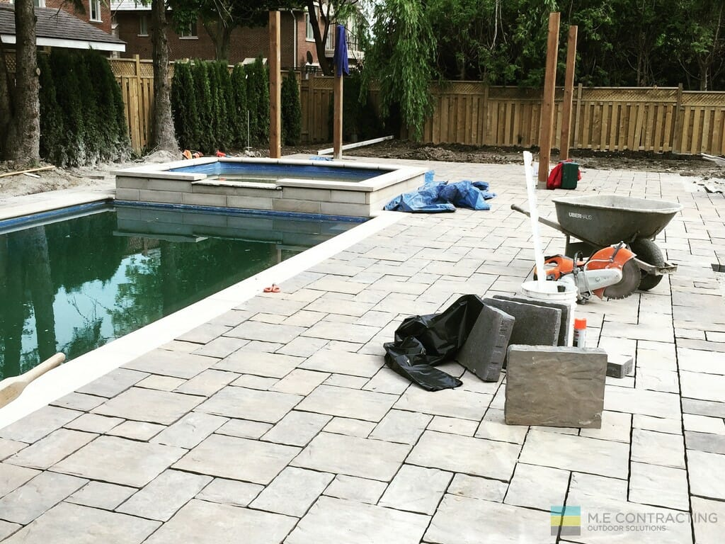 Landscaping project with fiberglass pool installation, hot tub, interlocking, pergola, cedar fence