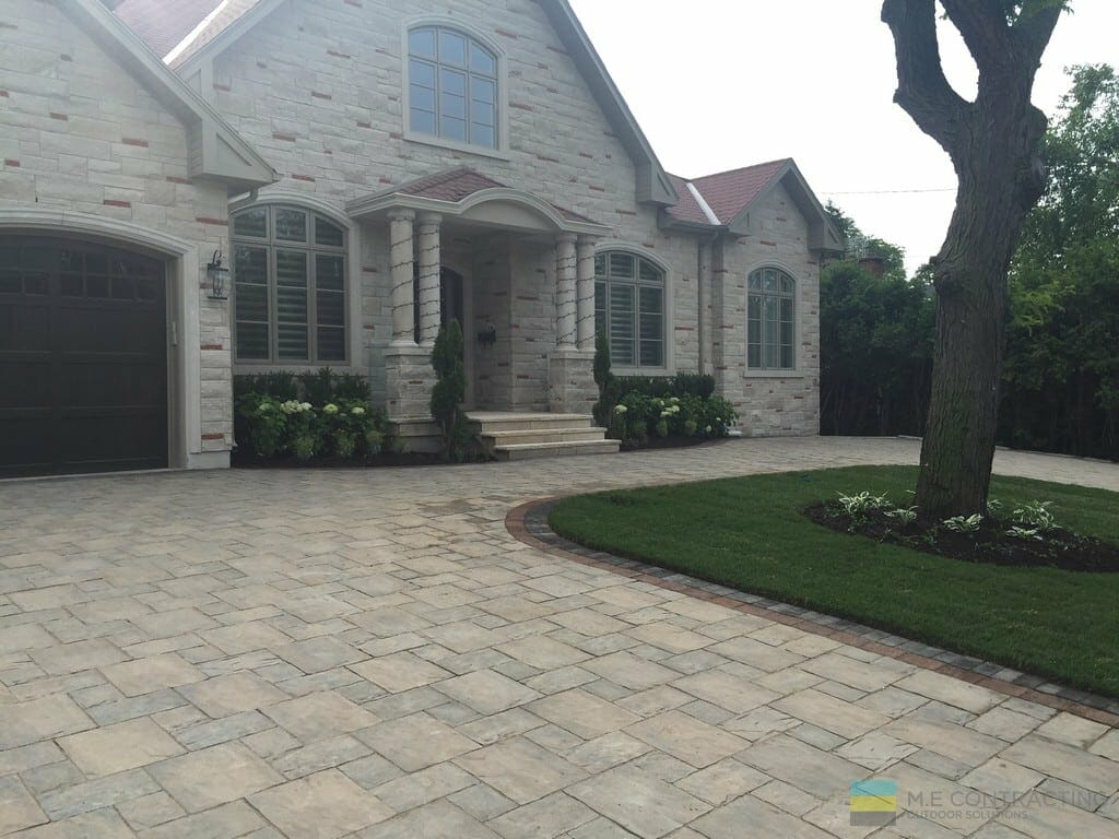 Landscaping project with heated driveway, interlocking and stone steps