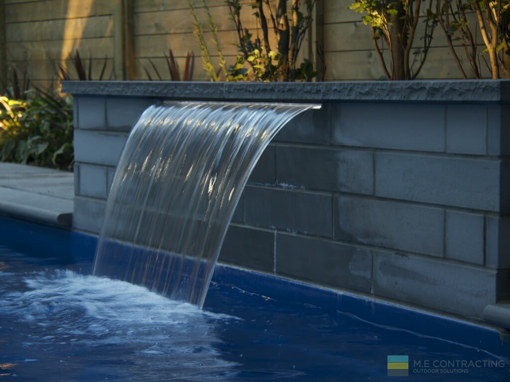 Landscaping, stone fountain, fiberglass pool, cedar fence