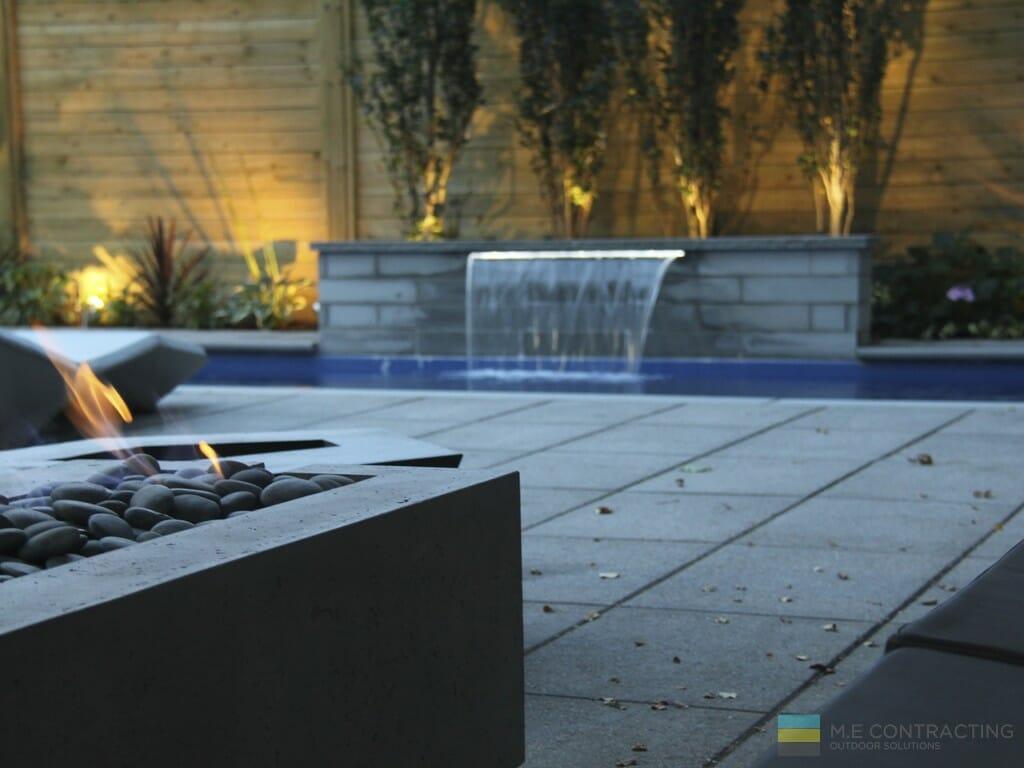 Fiberglass pool, stone fire pit, stone patio, cedar fence, landscaping