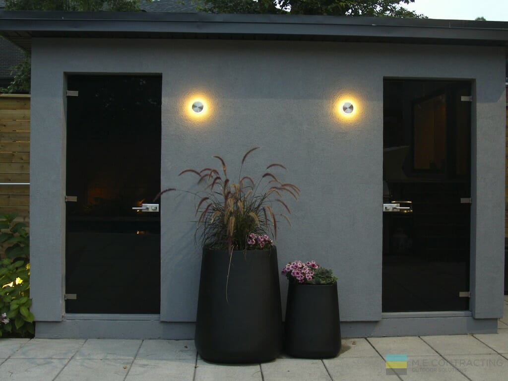 Landscaping, with stucco structure, lighting, stone patio, stainless steel clip