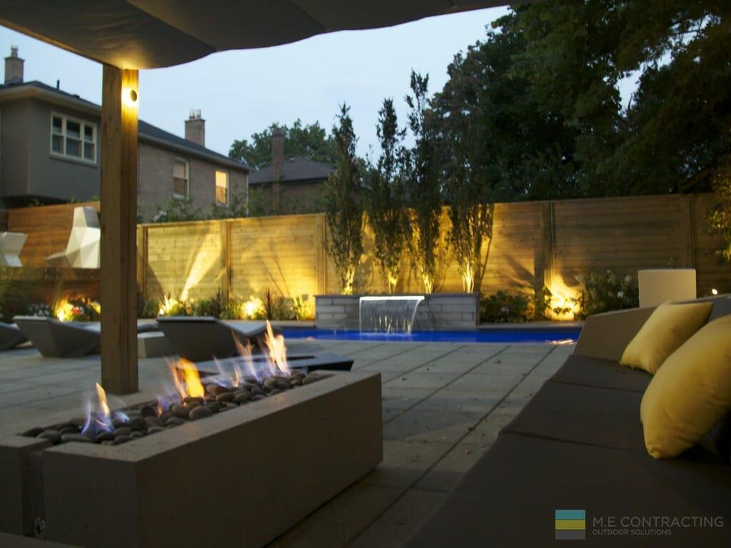 Fiberglass pool, stone fire pit, stone patio, cedar fence, landscaping, PVC deck